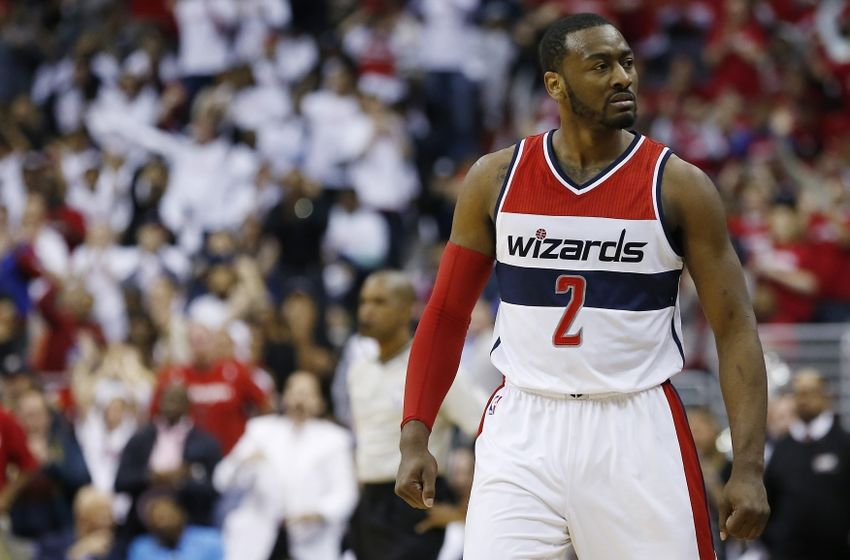 Apr 24, 2015; Washington, DC, USA; Washington Wizards guard John Wall (2) reacts on the court against the Toronto Raptors in the second quarter in game three of the first round of the NBA Playoffs at Verizon Center. Mandatory Credit: Geoff Burke-USA TODAY Sports