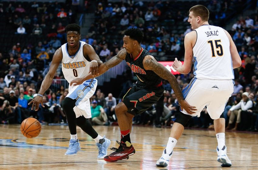 Jan 25, 2016; Denver, CO, USA; Denver Nuggets center Nikola Jokic (15) defends as guard Emmanuel Mudiay (0) dribbles the ball against Atlanta Hawks guard Jeff Teague (0) in the third quarter at the Pepsi Center. The Hawks defeated the Nuggets 119-105. Mandatory Credit: Isaiah J. Downing-USA TODAY Sports