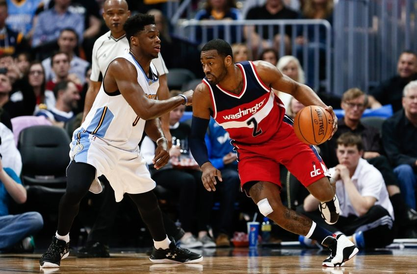 Mar 12, 2016; Denver, CO, USA; Denver Nuggets guard Emmanuel Mudiay (0) guards Washington Wizards guard John Wall (2) in the second quarter at the Pepsi Center. Mandatory Credit: Isaiah J. Downing-USA TODAY Sports