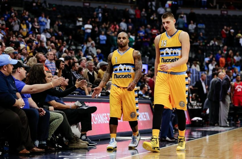 Nov 18, 2016; Denver, CO, USA; Denver Nuggets guard Jameer Nelson (1) and forward Nikola Jokic (15) come off the court in overtime against the Toronto Raptors at the Pepsi Center. The Raptors won 113-111 in overtime. Mandatory Credit: Isaiah J. Downing-USA TODAY Sports