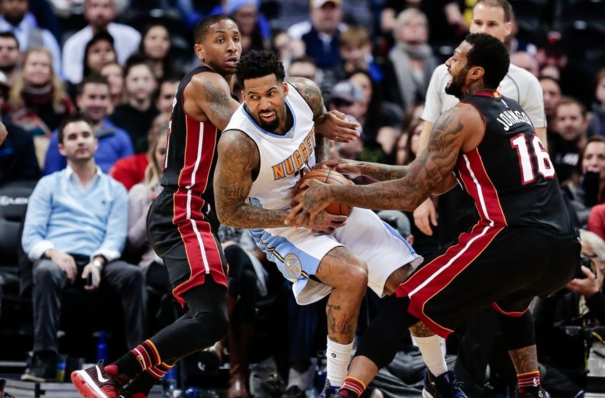 Nov 30, 2016; Denver, CO, USA; Denver Nuggets forward Wilson Chandler (21) battles for the ball with Miami Heat guard Rodney McGruder (17) and forward James Johnson (16) in the fourth quarter at the Pepsi Center. The Heat won 106-98. Mandatory Credit: Isaiah J. Downing-USA TODAY Sports