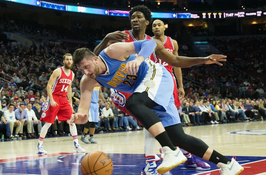 fDec 5, 2016; Philadelphia, PA, USA; Denver Nuggets center Jusuf Nurkic (23) loses control of the ball after being fouled by Philadelphia 76ers center Joel Embiid (21) during the second quarter at Wells Fargo Center. Mandatory Credit: Bill Streicher-USA TODAY Sports