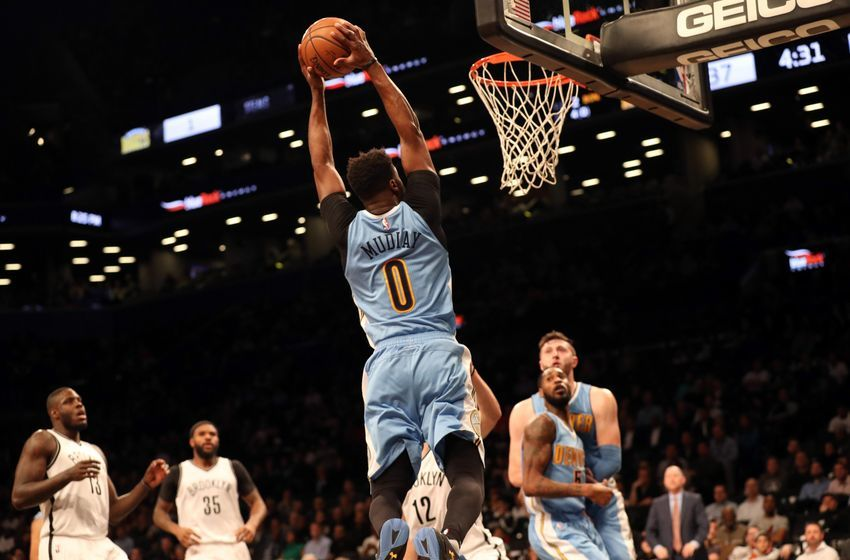 Dec 7, 2016; Brooklyn, NY, USA; Denver Nuggets guard Emmanuel Mudiay (0) reaches for the net during the second quarter against the Brooklyn Nets at Barclays Center. Mandatory Credit: Anthony Gruppuso-USA TODAY Sports
