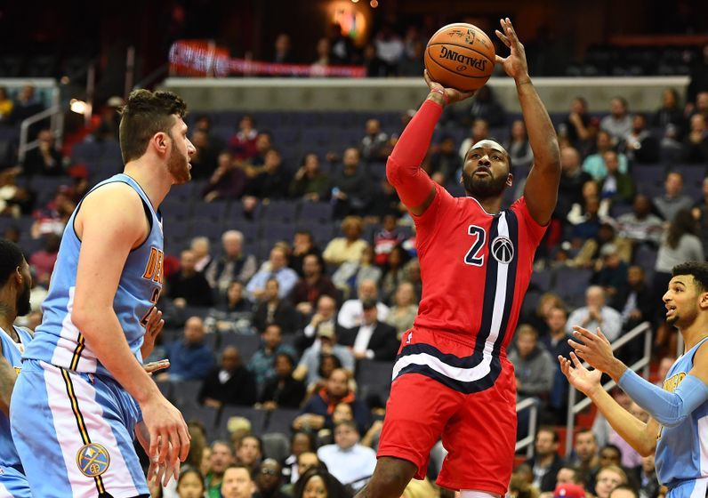Dec 8, 2016; Washington, DC, USA; Washington Wizards guard John Wall (2) attempts a shot against the Denver Nuggets during the second half at Verizon Center. The Washington Wizards won 92-85. Mandatory Credit: Brad Mills-USA TODAY Sports