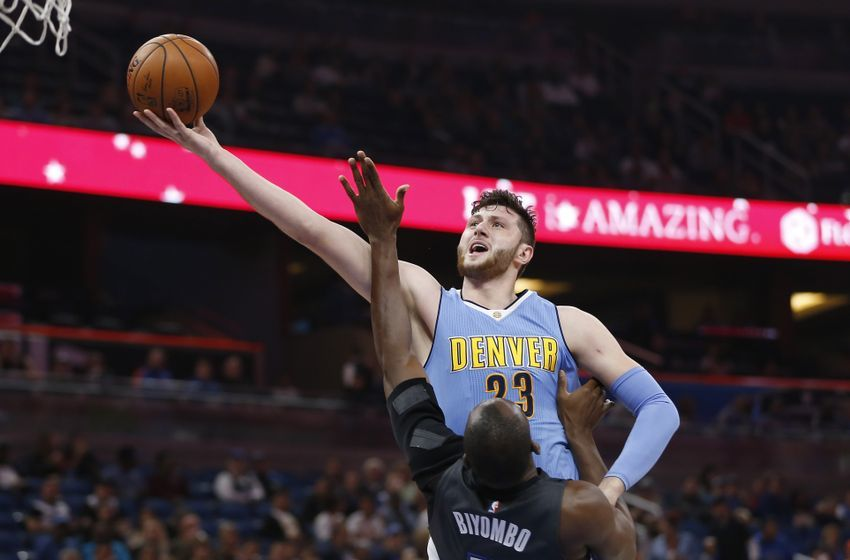 Dec 10, 2016; Orlando, FL, USA; Denver Nuggets center Jusuf Nurkic (23) shoots the ball over Orlando Magic center Bismack Biyombo (11) during the first quarter of an NBA basketball game at Amway Center. Mandatory Credit: Reinhold Matay-USA TODAY Sports