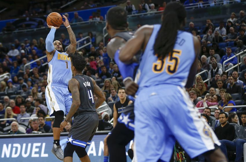 Dec 10, 2016; Orlando, FL, USA; Denver Nuggets guard Jameer Nelson (1) shoots a fall away jumper over Orlando Magic guard Elfrid Payton (4) during the second half of an NBA basketball game at Amway Center. The Nuggets won 121-113. Mandatory Credit: Reinhold Matay-USA TODAY Sports