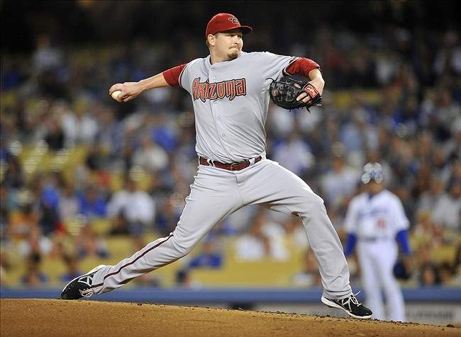 September 10, 2013; Los Angeles, CA, USA; Arizona Diamondbacks starting pitcher Trevor Cahill (35) pitches during the first inning against the Los Angeles Dodgers at Dodger Stadium. Mandatory Credit: Gary A. Vasquez-USA TODAY Sports
