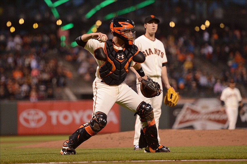 September 9, 2013; San Francisco, CA, USA; San Francisco Giants catcher Buster Posey (28, front) throws to first base for an out on a ground ball by Colorado Rockies catcher Yorvit Torrealba (8, not pictured) as Giants starting pitcher Tim Lincecum (55, back) looks on during the second inning at AT&T Park. Colorado Rockies third baseman Nolan Arenado (28, not pictured) scored on the play. Mandatory Credit: Kyle Terada-USA TODAY Sports