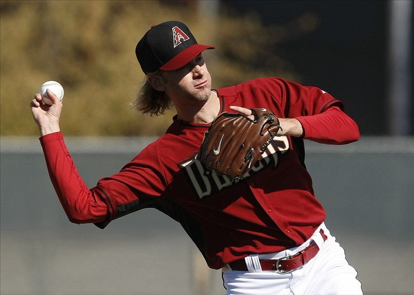 Feb 12, 2014; Scottsdale, AZ, USA; Arizona Diamondbacks pitcher Bronson Arroyo (61) throws home during camp at Salt River Fields. Mandatory Credit: Rick Scuteri-USA TODAY Sports