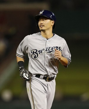 Aug 14, 2013; Arlington, TX, USA; Milwaukee Brewers right fielder Norichika Aoki (7) jogs back to first base after attempting to steal second base in the seventh inning against the Texas Rangers at Rangers Ballpark in Arlington. Texas won 5-4. Mandatory Credit: Tim Heitman-USA TODAY Sports