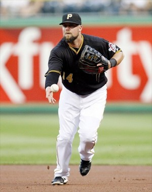 July 21, 2012; Pittsburgh, PA, USA; Pittsburgh Pirates first baseman Casey McGehee (14) flips the ball to first base for a putout against the Miami Marlins during the fourth inning at PNC Park. Mandatory Credit: Charles LeClaire-USA TODAY Sports