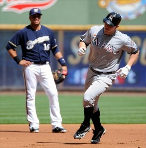 July 3, 2012; Milwaukee, WI, USA; Miami Marlins left fielder Logan Morrison (5) rounds the bases past Milwaukee Brewers third baseman Aramis Ramirez (16) after hitting a 2-run homer in the first inning at Miller Park. Mandatory Credit: Benny Sieu-USA TODAY Sports