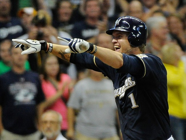 Sept 1, 2012; Milwaukee, WI, USA; Milwaukee Brewers first baseman Corey Hart (1) reacts after hitting a game-winning home run in the ninth inning against the Pittsburgh Pirates at Miller Park. The Brewers beat the Pirates 3-2. Mandatory Credit: Benny Sieu-USA TODAY Sports