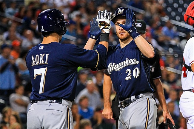 Sep 23, 2013; Atlanta, GA, USA; Milwaukee Brewers catcher Jonathan Lucroy (20) celebrates a two-run home run with right fielder Norichika Aoki (7) in the fifth inning against the Atlanta Braves at Turner Field. Mandatory Credit: Daniel Shirey-USA TODAY Sports