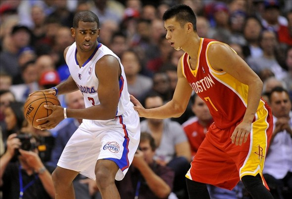November 4, 2013; Los Angeles, CA, USA; Los Angeles Clippers point guard Chris Paul (3) moves the ball against the defense of Houston Rockets point guard Jeremy Lin (7) during the first half at Staples Center. Mandatory Credit: Gary A. Vasquez-USA TODAY Sports