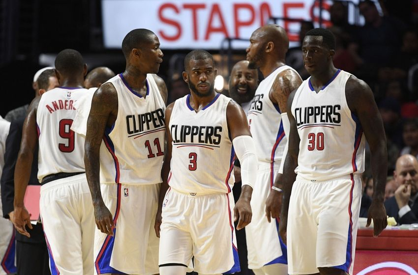 Oct 5, 2016; Los Angeles, CA, USA; Los Angeles Clippers guard Chris Paul (3) walks on the court with guard Jamal Crawford (11) and guard CJ Wilcox (30) during the second quarter against the Toronto Raptors at Staples Center. Mandatory Credit: Kelvin Kuo-USA TODAY Sports