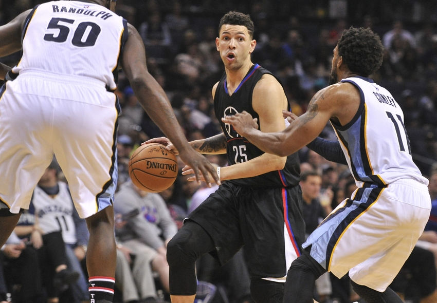 Nov 4, 2016; Memphis, TN, USA; Los Angeles Clippers guard Austin Rivers (25) handles the ball against Memphis Grizzlies forward Zach Randolph (50) and Memphis Grizzlies guard Mike Conley (11) during the second half at FedExForum. Los Angeles Clippers beat the Memphis Grizzlies 98-88. Mandatory Credit: Justin Ford-USA TODAY Sports