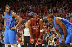 Dec. 25, 2012; Miami, FL, USA; Oklahoma City Thunder small forward Kevin Durant (left) , Miami Heat shooting guard Dwyane Wade (center) and Thunder power forward Serge Ibaka (right) talk during the second half at American Airlines Arena. Mandatory Credit: Steve Mitchell-USA TODAY Sports