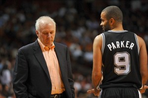 Oct 19, 2013; Miami, FL, USA; San Antonio Spurs head coach Gregg Popovich (left) talks with point guard Tony Parker (right) during a timeout in the second quarter against the Miami Heat at American Airlines Arena. Mandatory Credit: Steve Mitchell-USA TODAY Sports