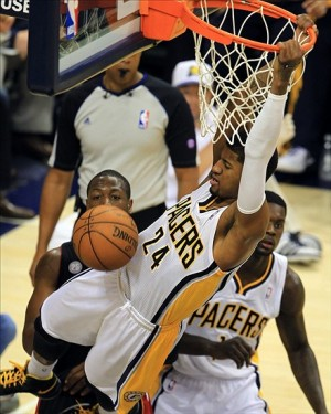 May 28, 2013; Indianapolis, IN, USA; Indiana Pacers small forward Paul George (24) dunks the ball against the Miami Heat in game four of the Eastern Conference finals of the 2013 NBA Playoffs at Bankers Life Fieldhouse. Mandatory Credit: Pat Lovell-USA TODAY Sports