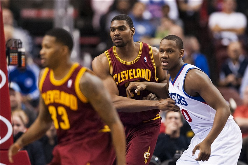 Nov 8, 2013; Philadelphia, PA, USA; Cleveland Cavaliers center Andrew Bynum (21) defends Philadelphia 76ers center Lavoy Allen (50) during the first quarter at Wells Fargo Center. Mandatory Credit: Howard Smith-USA TODAY Sports