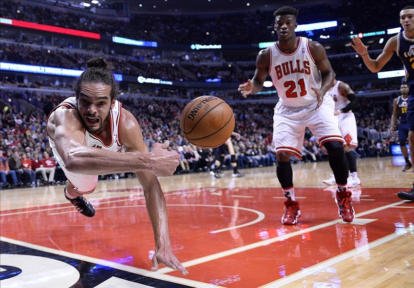 Nov 8, 2013; Chicago, IL, USA; Chicago Bulls center Joakim Noah (13) dives to make a rebound against the Utah Jazz during the first quarter at the United Center. Mandatory Credit: Mike DiNovo-USA TODAY Sports