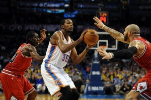Dec 19, 2013; Oklahoma City, OK, USA; Oklahoma City Thunder small forward Kevin Durant (35) handles the ball while being defended by Chicago Bulls power forward Carlos Boozer (5) and Bulls small forward Tony Snell (20) during the fourth quarter at Chesapeake Energy Arena. Mandatory Credit: Mark D. Smith-USA TODAY Sports