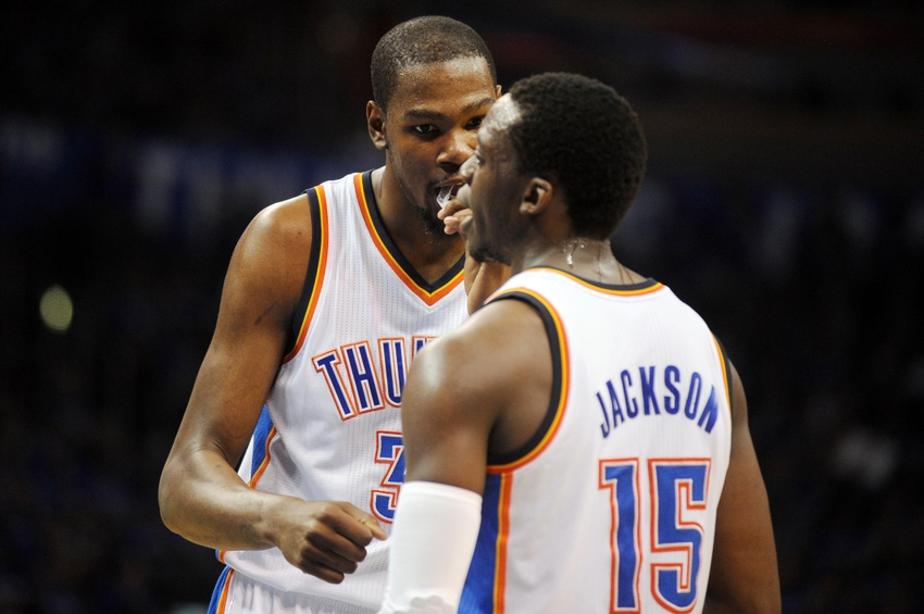 May 25, 2014; Oklahoma City, OK, USA; Oklahoma City Thunder forward Kevin Durant (35) talks to guard Reggie Jackson (15) during a break in play against the San Antonio Spurs during the second quarter in game three of the Western Conference Finals of the 2014 NBA Playoffs at Chesapeake Energy Arena. Mandatory Credit: Mark D. Smith-USA TODAY Sports