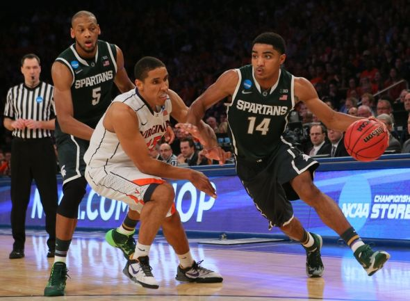Mar 28, 2014; New York, NY, USA; Michigan State Spartans guard Gary Harris (14) drives to the basket against Virginia Cavaliers guard Malcolm Brogdon (15) during the second half in the semifinals of the east regional of the 2014 NCAA Mens Basketball Championship tournament at Madison Square Garden. Mandatory Credit: Adam Hunger-USA TODAY Sports