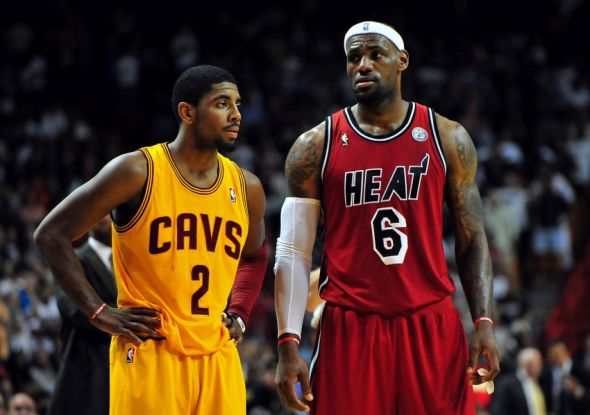 Feb 24, 2013; Miami, FL, USA; Cleveland Cavaliers point guard Kyrie Irving (2) and Miami Heat small forward LeBron James (6) during the second half at the American Airlines Arena. MIami won 109-105. Mandatory Credit: Steve Mitchell-USA TODAY Sports