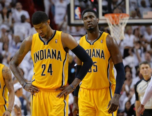 May 30, 2014; Miami, FL, USA; Indiana Pacers forward Paul George (24) and center Roy Hibbert (55) react during the second half in game six of the Eastern Conference Finals of the 2014 NBA Playoffs against the Miami Heat at American Airlines Arena. Mandatory Credit: Steve Mitchell-USA TODAY Sports