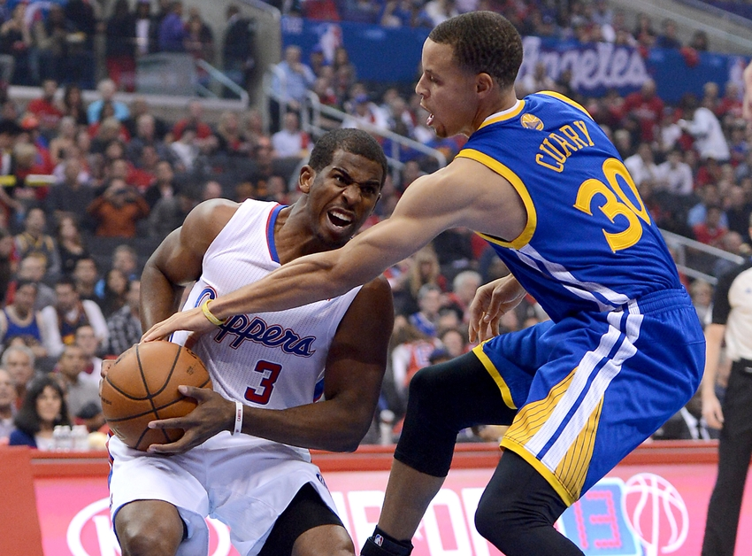 Oct 31, 2013; Los Angeles, CA, USA; Golden State Warriors point guard Stephen Curry (30) fouls Los Angeles Clippers point guard Chris Paul (3) in the first quarter of the game at Staples Center. Mandatory Credit: Jayne Kamin-Oncea-USA TODAY Sports