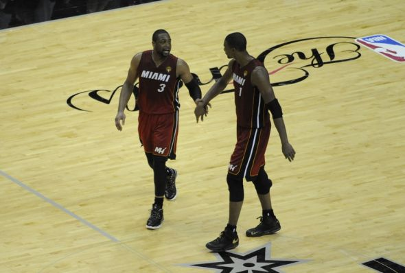 Jun 5, 2014; San Antonio, TX, USA; Miami Heat guard Dwyane Wade (3) talks with forward Chris Bosh (1) after a timeout in the second half against the San Antonio Spurs in game one of the 2014 NBA Finals at AT&T Center. Mandatory Credit: Brendan Maloney-USA TODAY Sports