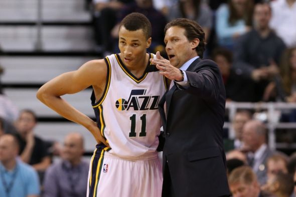 Apr 8, 2015; Salt Lake City, UT, USA; Utah Jazz head coach Quin Snyder gives Utah Jazz guard <a rel=