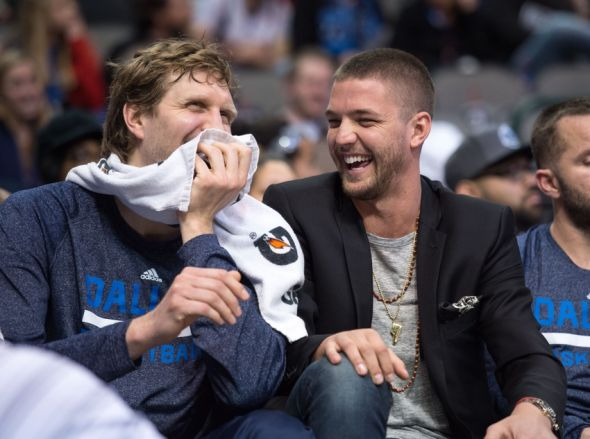 Feb 22, 2015; Dallas, TX, USA; Dallas Mavericks forward Dirk Nowitzki (41) and forward Chandler Parsons (25) share a laugh on the bench during the second half of the game between the Mavericks and the Charlotte Hornets at the American Airlines Center. The Mavericks defeated the Hornets 92-81. Mandatory Credit: Jerome Miron-USA TODAY Sports