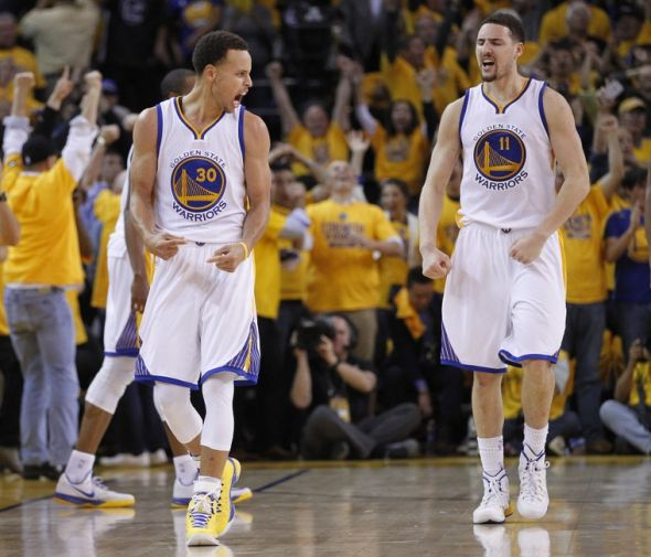 May 21, 2015; Oakland, CA, USA; Golden State Warriors guard Stephen Curry (30) and guard Klay Thompson (11) celebrate the 99-98 victory against the Houston Rockets following the second half in game two of the Western Conference Finals of the NBA Playoffs. at Oracle Arena. Mandatory Credit: Cary Edmondson-USA TODAY Sports