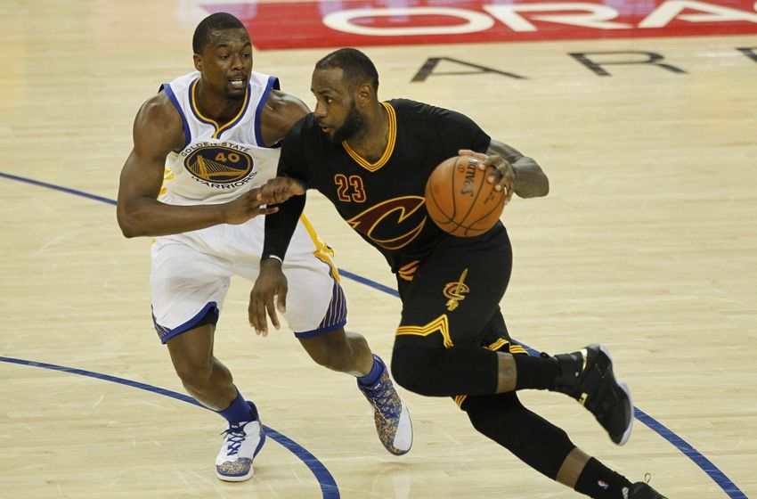 Jun 2, 2016; Oakland, CA, USA; Cleveland Cavaliers forward LeBron James (23) shoots the ball against Golden State Warriors forward Harrison Barnes (40) in game one of the NBA Finals at Oracle Arena. Mandatory Credit: Ezra Shaw-Pool Photo via USA TODAY Sports