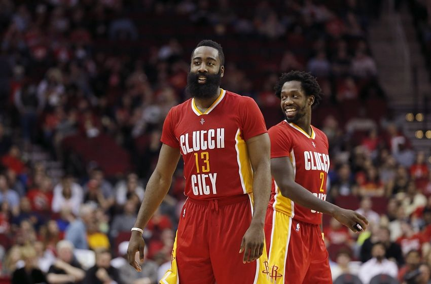 Jan 7, 2016; Houston, TX, USA; Houston Rockets guard James Harden (13) and guard Patrick Beverley (2) smile while playing against the Utah Jazz in the second half at Toyota Center. Rockets won 103 to 94. Mandatory Credit: Thomas B. Shea-USA TODAY Sports
