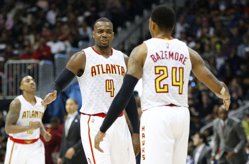 Apr 1, 2016; Atlanta, GA, USA; Atlanta Hawks forward Paul Millsap (4) high fives forward Kent Bazemore (24) against the Cleveland Cavaliers in the fourth quarter at Philips Arena. The Cavaliers defeated the Hawks 110-108 in overtime. Mandatory Credit: Brett Davis-USA TODAY Sports