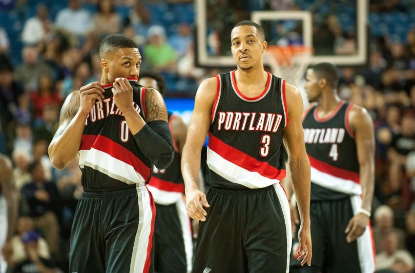 Apr 5, 2016; Sacramento, CA, USA; Portland Trail Blazers guard Damian Lillard (0) and guard C.J. McCollum (3) walk up the court during the fourth quarter of the game against the Sacramento Kings at Sleep Train Arena. The Portland Trail Blazers defeated the Sacramento Kings 115-107. Mandatory Credit: Ed Szczepanski-USA TODAY Sports