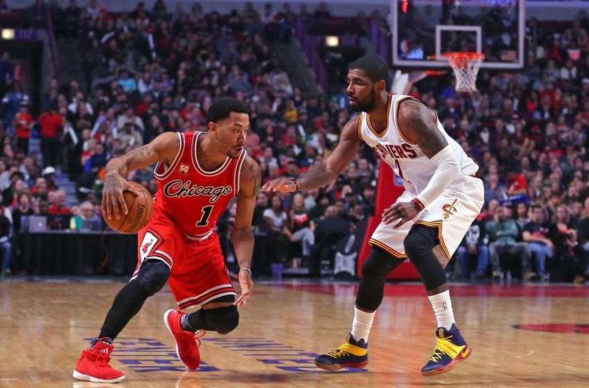 Apr 9, 2016; Chicago, IL, USA; Chicago Bulls guard Derrick Rose (1) is defended by Cleveland Cavaliers guard Kyrie Irving (2) during the first half at the United Center. Mandatory Credit: Dennis Wierzbicki-USA TODAY Sports