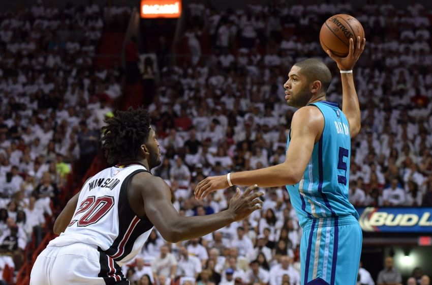 Apr 17, 2016; Miami, FL, USA; Charlotte Hornets guard Nicolas Batum (5) looks to pass the ball as Miami Heat forward Justise Winslow (20) defends during the first half in game one of the first round of the NBA Playoffs at American Airlines Arena. Mandatory Credit: Steve Mitchell-USA TODAY Sports