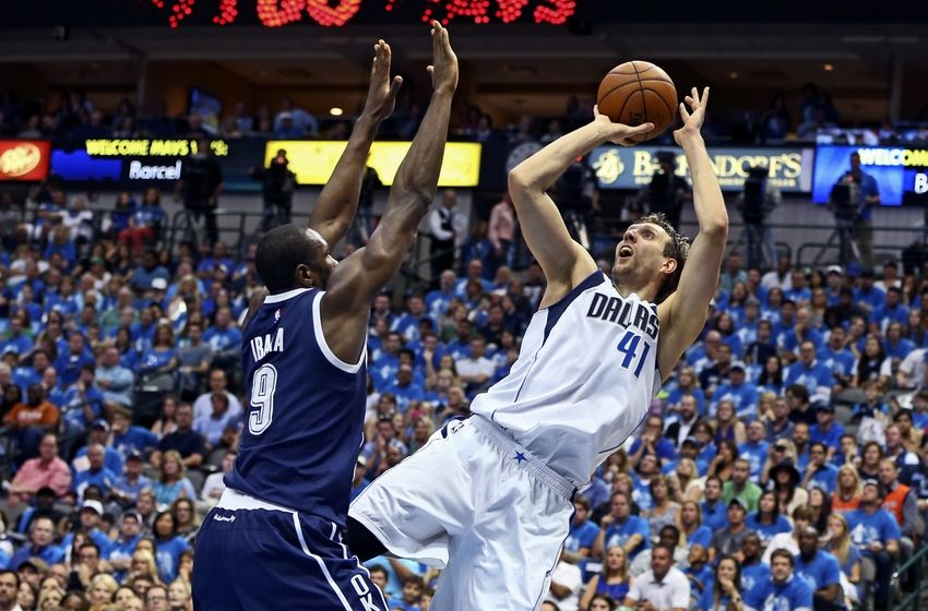 Apr 23, 2016; Dallas, TX, USA; Dallas Mavericks forward Dirk Nowitzki (41) shoots as Oklahoma City Thunder forward Serge Ibaka (9) defends during the second quarter in game four of the first round of the NBA Playoffs at American Airlines Center. Mandatory Credit: Kevin Jairaj-USA TODAY Sports