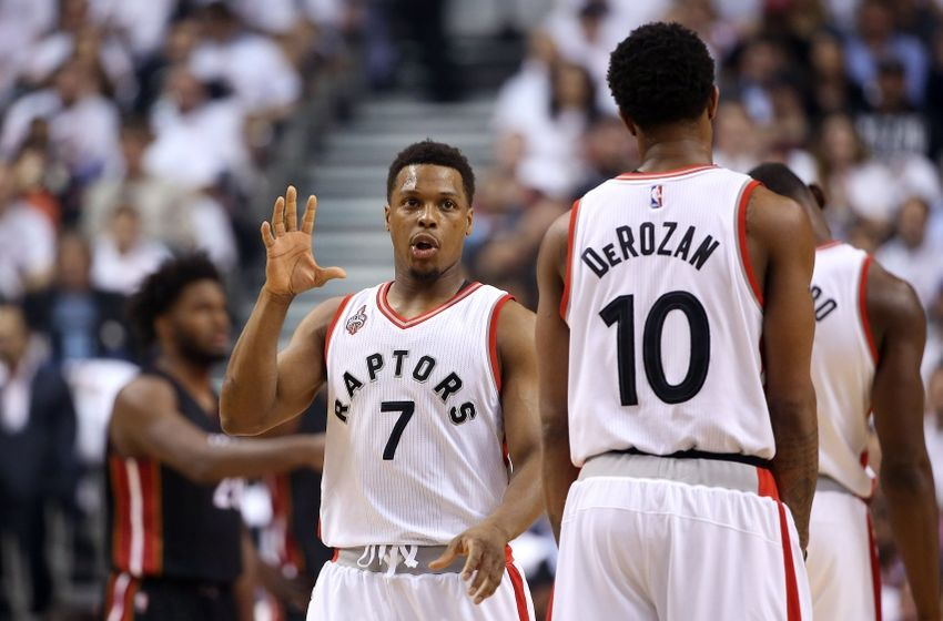 May 11, 2016; Toronto, Ontario, CAN; Toronto Raptors point guard Kyle Lowry (7) talks to guard DeMar DeRozan (10) against the Miami Heat in game five of the second round of the NBA Playoffs at Air Canada Centre. The Raptors beat the Heat 99-91. Mandatory Credit: Tom Szczerbowski-USA TODAY Sports