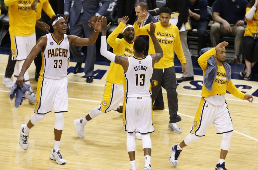 Apr 29, 2016; Indianapolis, IN, USA; Indiana Pacers forward Paul George (13) celebrates with center Myles Turner (33) and guard Ty Lawson (10) against the Toronto Raptors during the second half in game six of the first round of the 2016 NBA Playoffs at Bankers Life Fieldhouse. The Pacers won 101-83. Mandatory Credit: Brian Spurlock-USA TODAY Sports