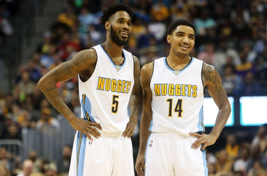 Dec 22, 2015; Denver, CO, USA; Denver Nuggets forward Will Barton (5) and guard Gary Harris (14) react during the first half against the Los Angeles Lakers at Pepsi Center. Mandatory Credit: Chris Humphreys-USA TODAY Sports