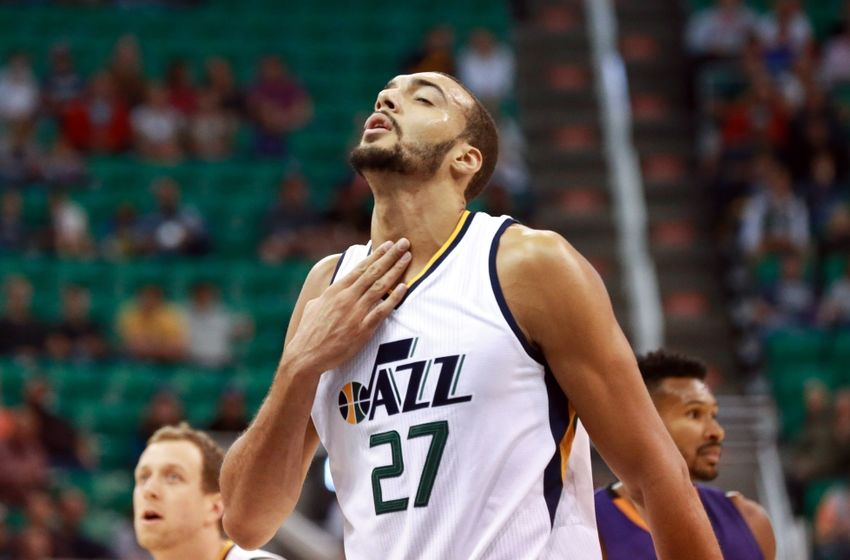 Oct 12, 2016; Salt Lake City, UT, USA; Utah Jazz center Rudy Gobert (27) rubs his throat after he gets hit in the neck during the first quarter against the Phoenix Suns at Vivint Smart Home Arena. Mandatory Credit: Chris Nicoll-USA TODAY Sports