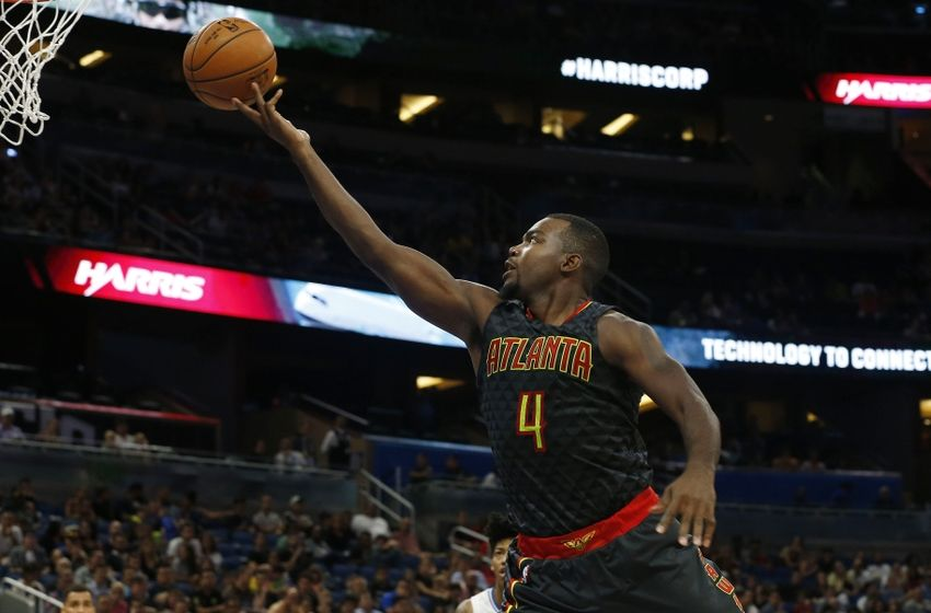 Oct 16, 2016; Orlando, FL, USA; Atlanta Hawks forward Paul Millsap (4) shoots the ball against the Orlando Magic during the second half at Amway Center. The Hawks won 105-98. Mandatory Credit: Kim Klement-USA TODAY Sports