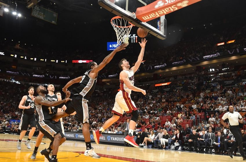 Oct 30, 2016; Miami, FL, USA; Miami Heat guard Goran Dragic (7) scores a basket past San Antonio Spurs forward Kawhi Leonard (2) during the second half at American Airlines Arena. The Spurs won 106-99. Mandatory Credit: Steve Mitchell-USA TODAY Sports