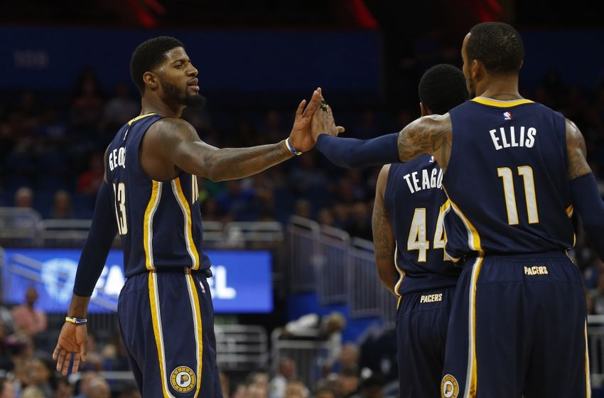 Oct 14, 2016; Orlando, FL, USA; Indiana Pacers forward Paul George (13) and guard Monta Ellis (11) high five against the Orlando Magic during the first quarter at Amway Center. Mandatory Credit: Kim Klement-USA TODAY Sports
